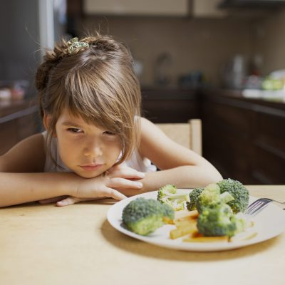 front-view-picky-girl-refuse-vegetables